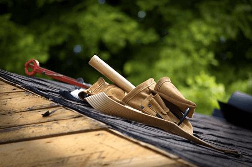 roofer tool belt on roof